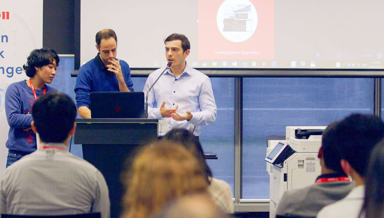 Innovators presenting at a Paddl Games innovation challenge for Canon Australia